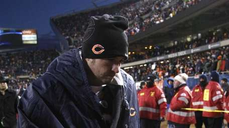 Chicago Bears quarterback Jay Cutler (6) heads off