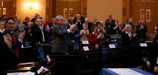 Electoral College members celebrate after casting their votes