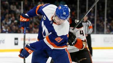 The Islanders' Michael Dal Colle takes a shot