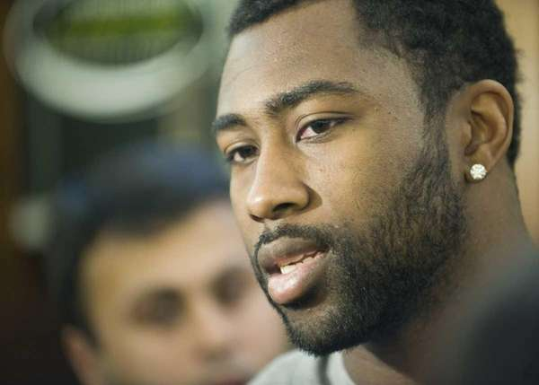 Jets cornerback Darrelle Revis talks to reporters in