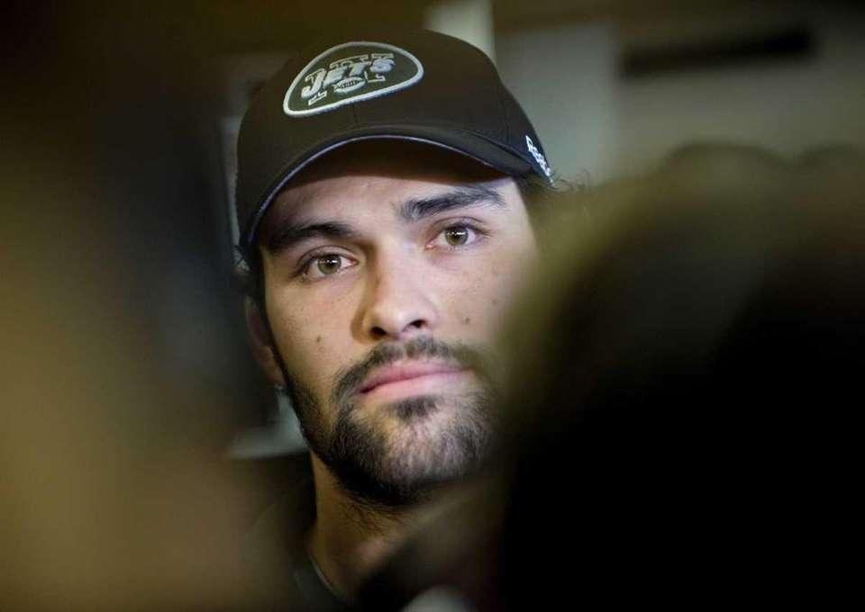 New York Jets quarterback Mark Sanchez talks to
