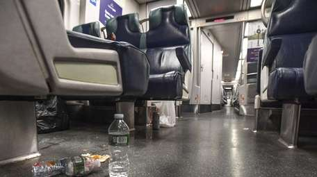 Trash is strewn about the floor and seats