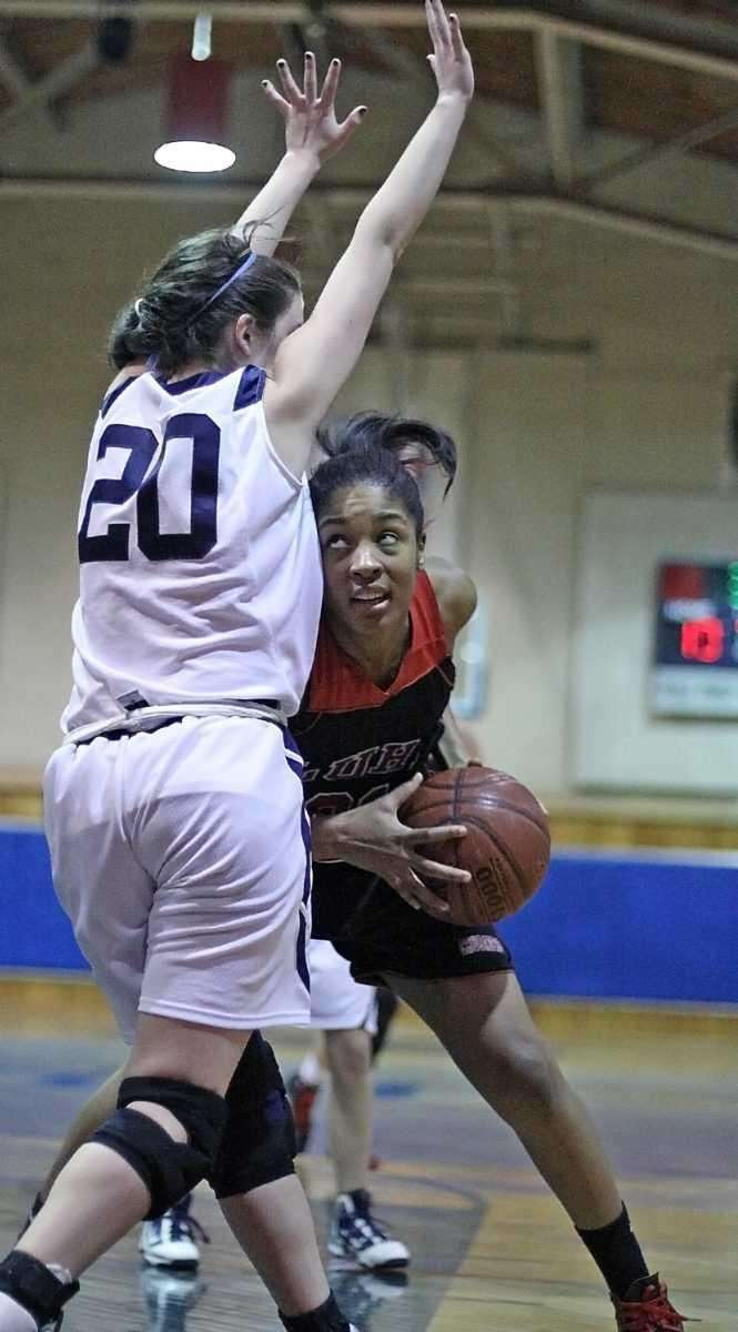 Long Island Lutheran's Sade Gibbons tries to get