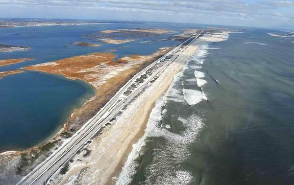 Police comb sand dunes and marshland along Ocean