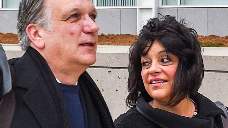 Edward and Linda Mangano arrive Wednesday at federal