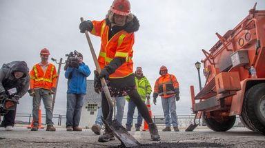 Nassau County Executive Laura Curran fills a pothole