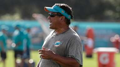 Miami Dolphins offensive coordinator Dowell Loggains watches at