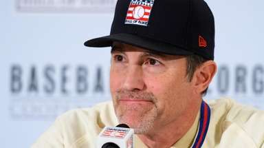 Mike Mussina speaks to the press at the