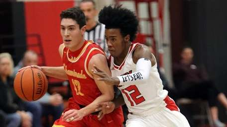 Chaminade's Michael O'Connell (12) drives up the court