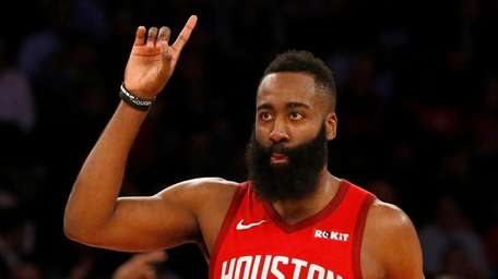 James Harden #13 of the Houston Rockets reacts