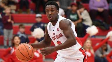 Stony Brook guard Jaron Cornish dribbles the ball