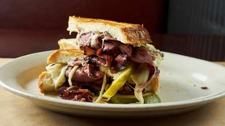 Pastrami grilled cheese with Swiss, mustard, pickles, at