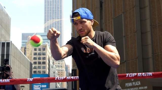 Vasil Lomachenko punches a tennis ball tethered to