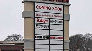 A sign at New Village Plaza, being built