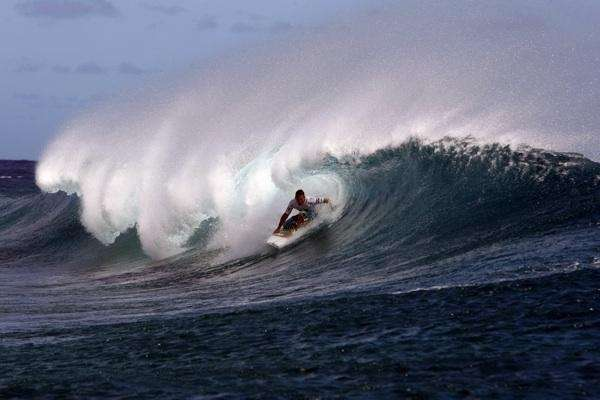 Andy Irons competes performs during the final of