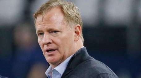 NFL commissioner Roger Goodell speaks with Seahawks head