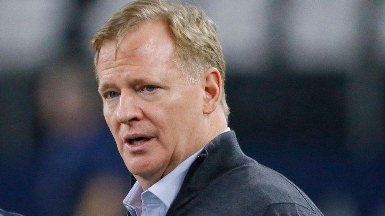 NFL commissioner Roger Goodell speaks with Seahawks head