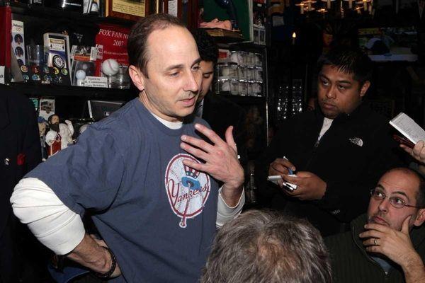 FILE - Brian Cashman as a guest bartender