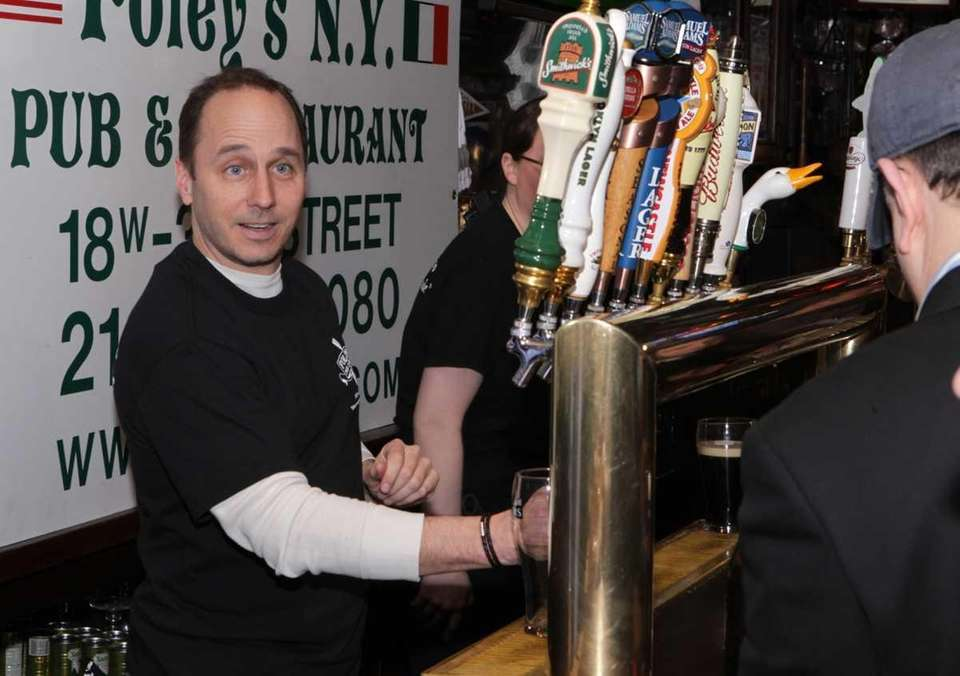 Brian Cashman was a guest bartender at Foley's