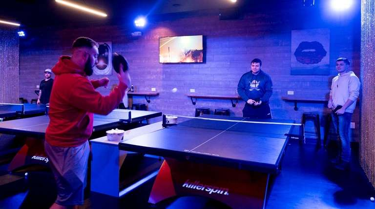Mike Chiofalo, 23, of Massapequa, plays pingpong with