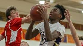 Ahkee Anderson of Greenport goes up for a