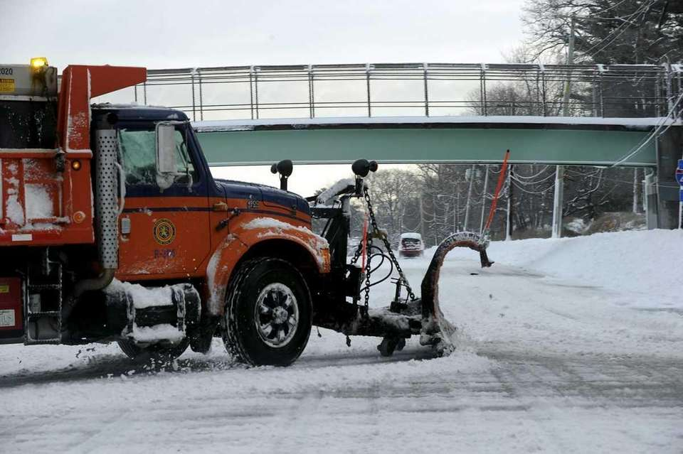 A snowplow at work on Jericho Turnpike in