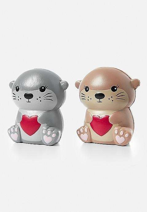 Silver and gold otter squishy figures feature bright