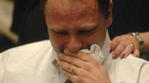 Mark Szpila is pictured during a press conference