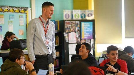 Substitute teacher James Bulva teaches an English classroom