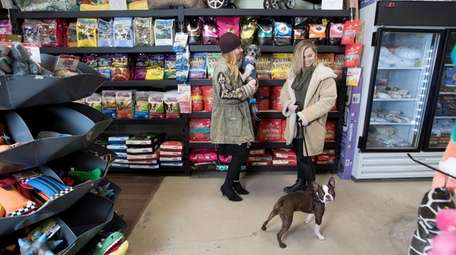 Kelly Franké, left, holds her dog Thumper, and