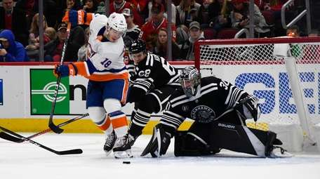 Islanders lineman Anthony Beauvillier shoots against Blackhawks defenseman