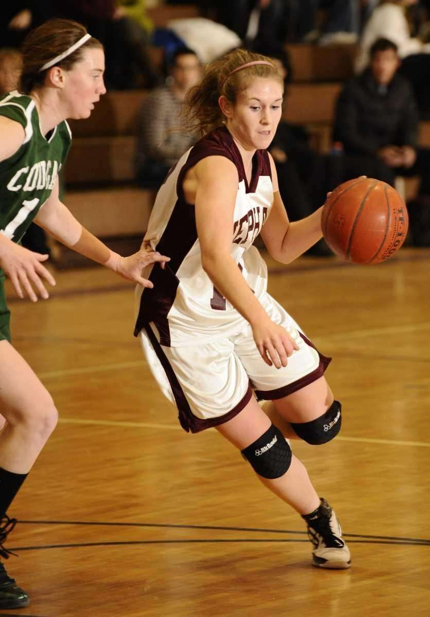 Mepham's Jillian Picinich drives to the basket guarded
