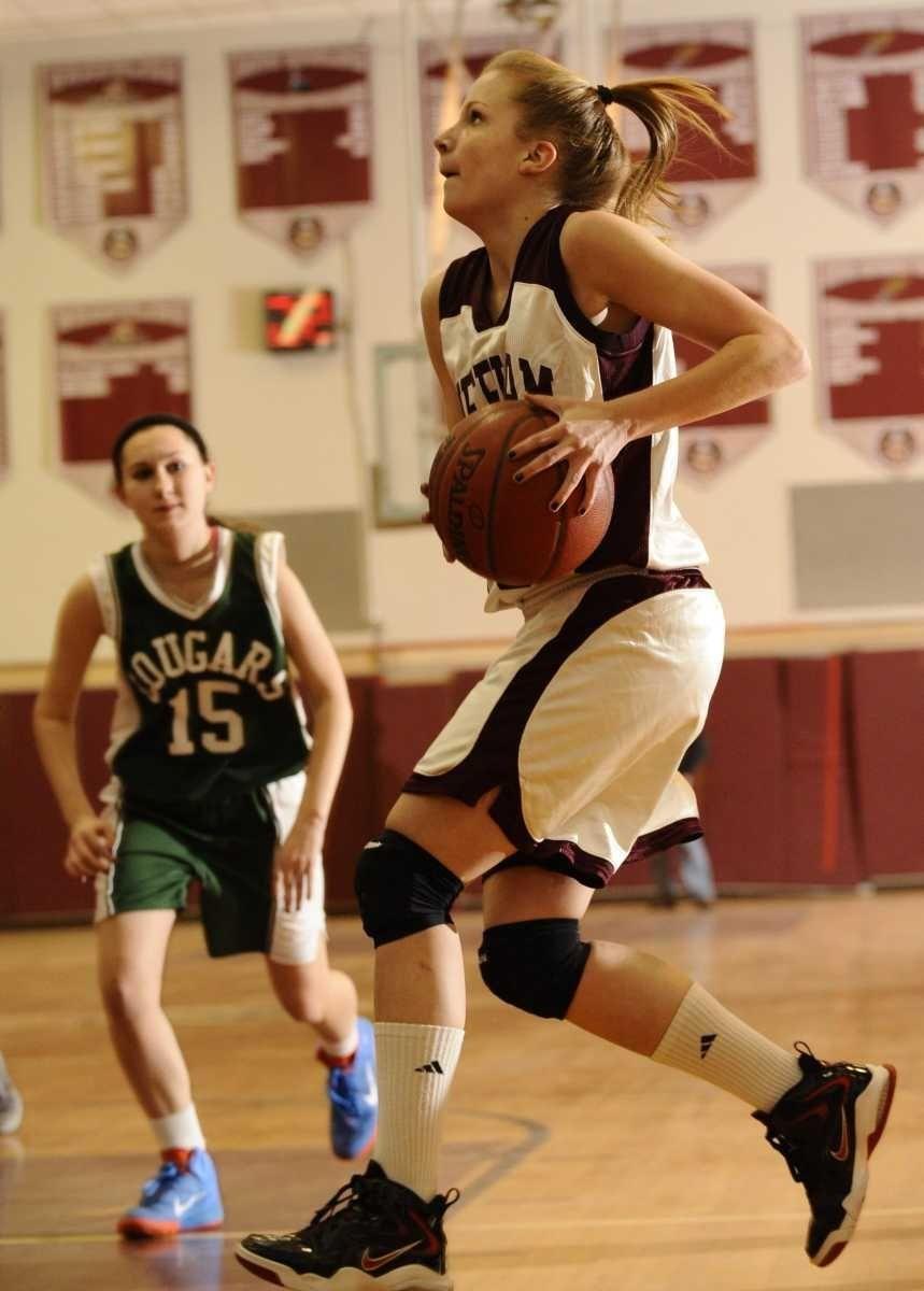Mepham's Kristen O'Brien drives to the basket along