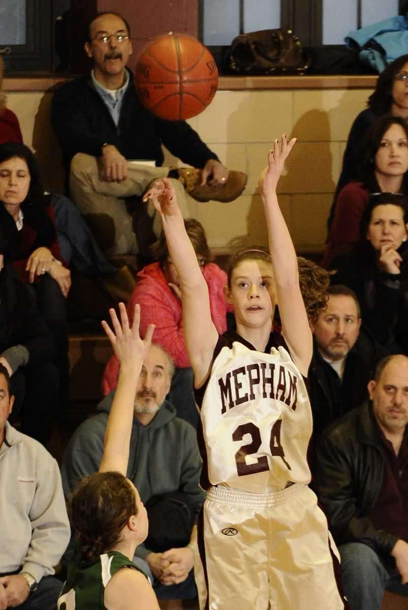 Mepham's Megan Anderson shoots against Bellmore JFK. (Jan.