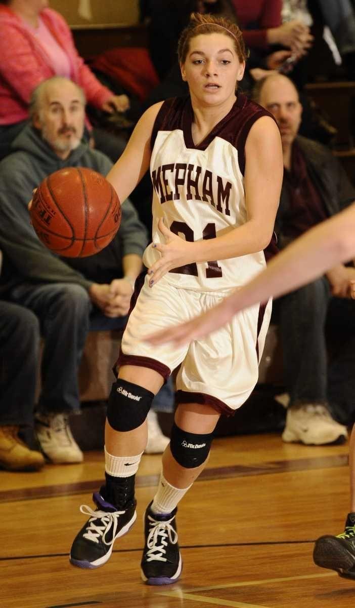 Mepham's Mary Galgano dribbles the ball against Bellmore