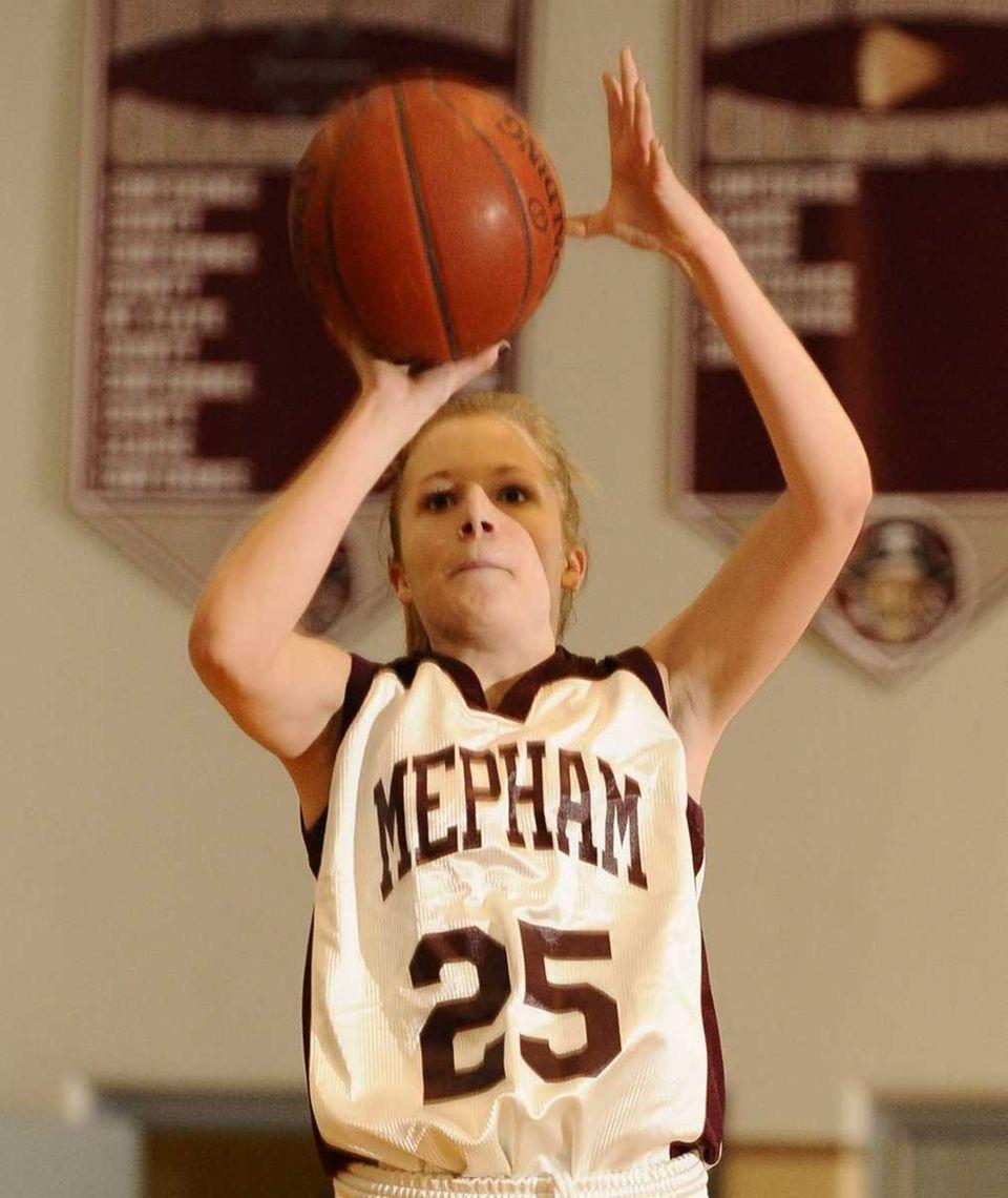Mepham's Kristen O'Brien shoots against Bellmore JFK. (Jan.