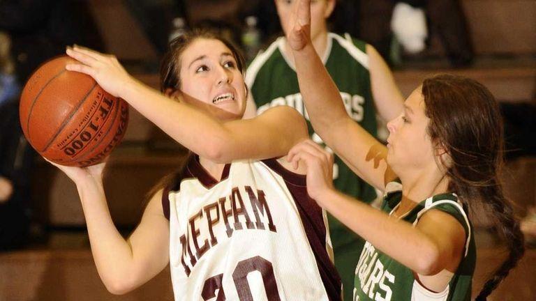 Mepham's Nicole Castaldo looks to shoot past Bellmore