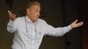 Fred Wilpon gestures as he talks to fans
