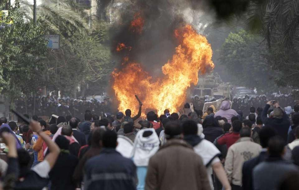 Protesters throw firebombs at riot police after police