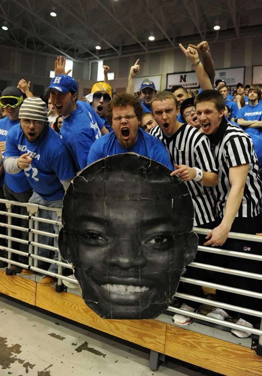 Hofstra fans cheer as they hold up a