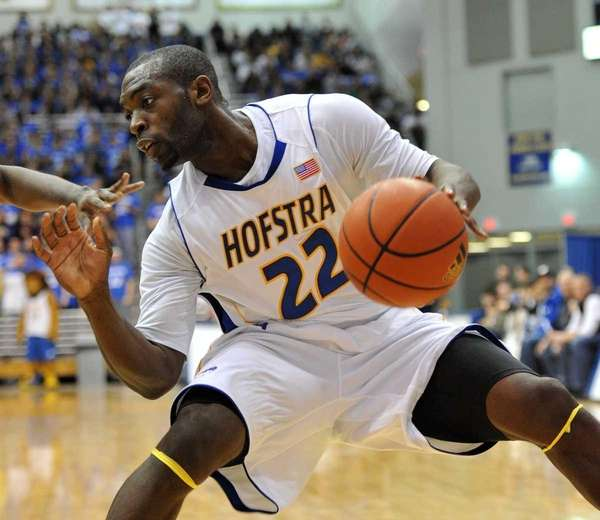 Hofstra point guard Charles Jenkins controls the ball