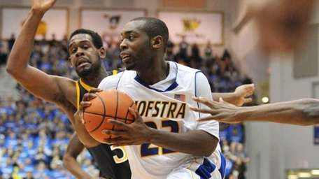 Charles Jenkins drives to the basket against Drexel