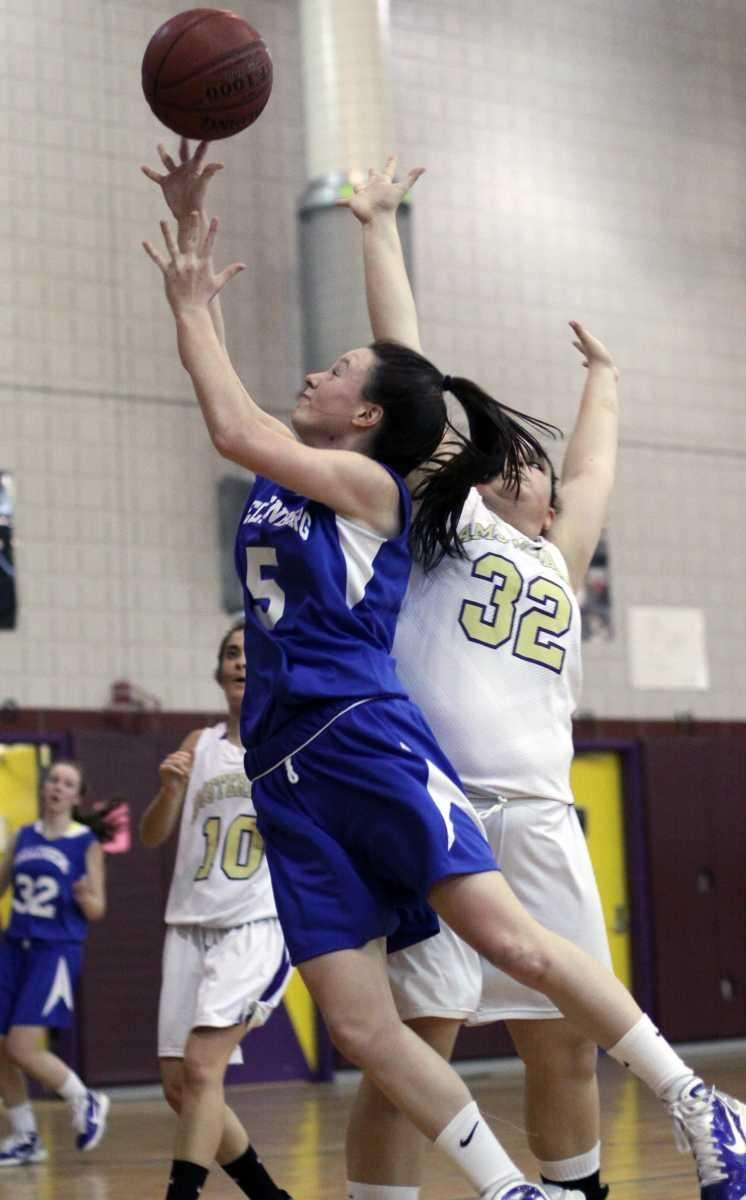 Kellenberg's Kathryn Flynn gets the basket against Amsterdam