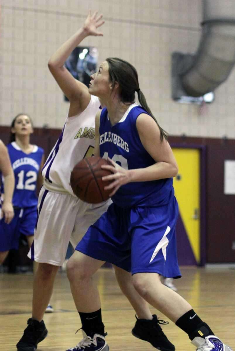 Kellenberg's Kathleen Sima under the basket against Amsterdam