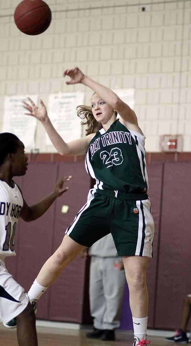 A cross-court pass from Holy Trinity's Katie Poppe
