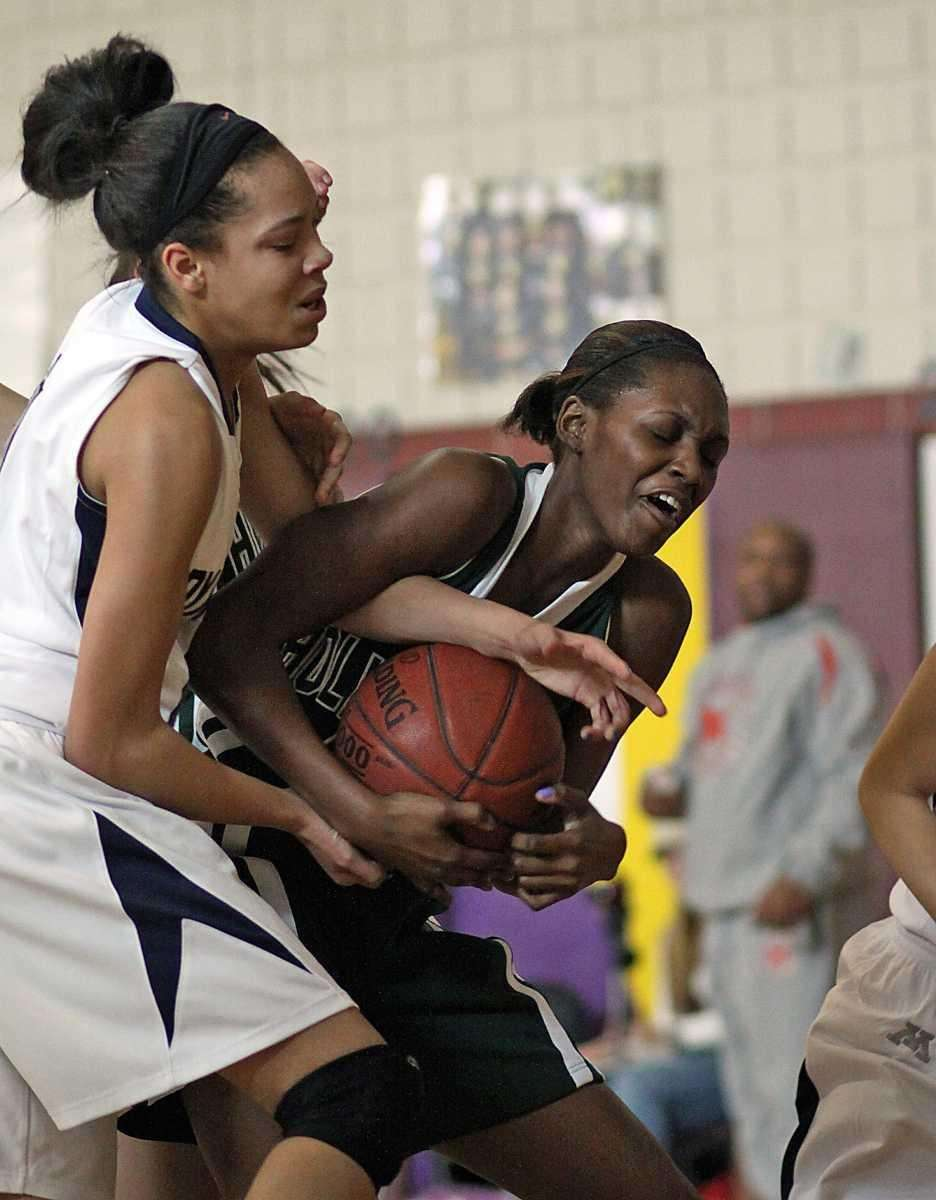 Holy Trinity's Staci Barrett fights off Midwood defenders