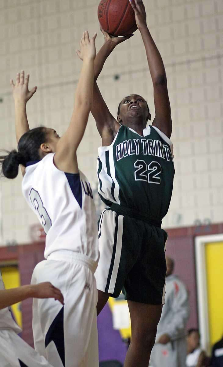 Holy Trinity's Staci Barrett shoots over the defender