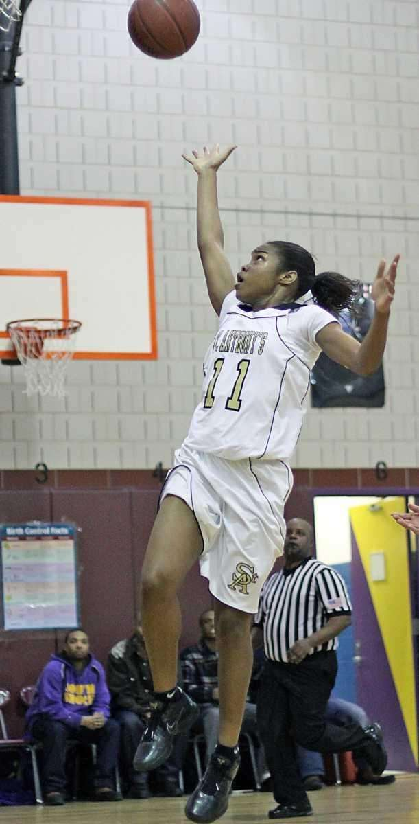 St. Anthony's Lauren Williams with the basket during