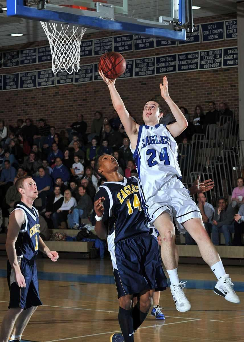 Hauppauge's Jon Velazquez drives for the layup on