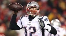 Tom Brady of the Patriots throws a pass